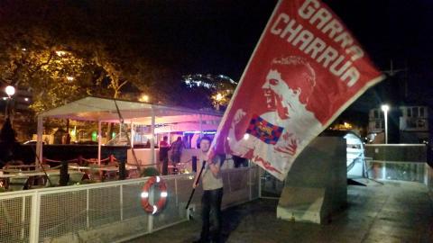 PBL member celebrating with Suarez flag: Garra Charrua!